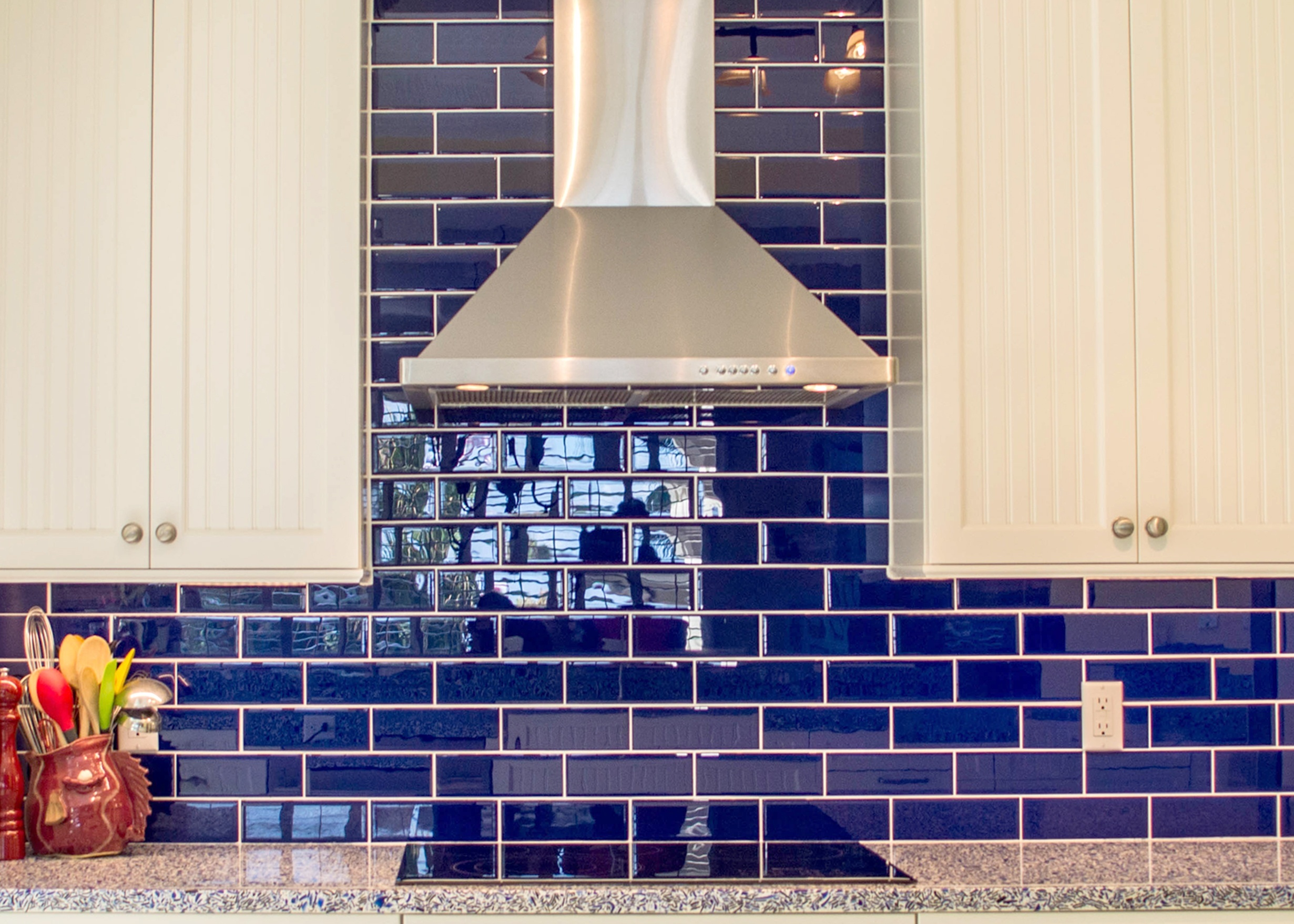 featured_5vetrazzo-recycled-glass-in-cobalt-skye-for-countertops-and-creative-kitchen-storage-by-waterview-kitchens-close-up-of-cobalt-tile